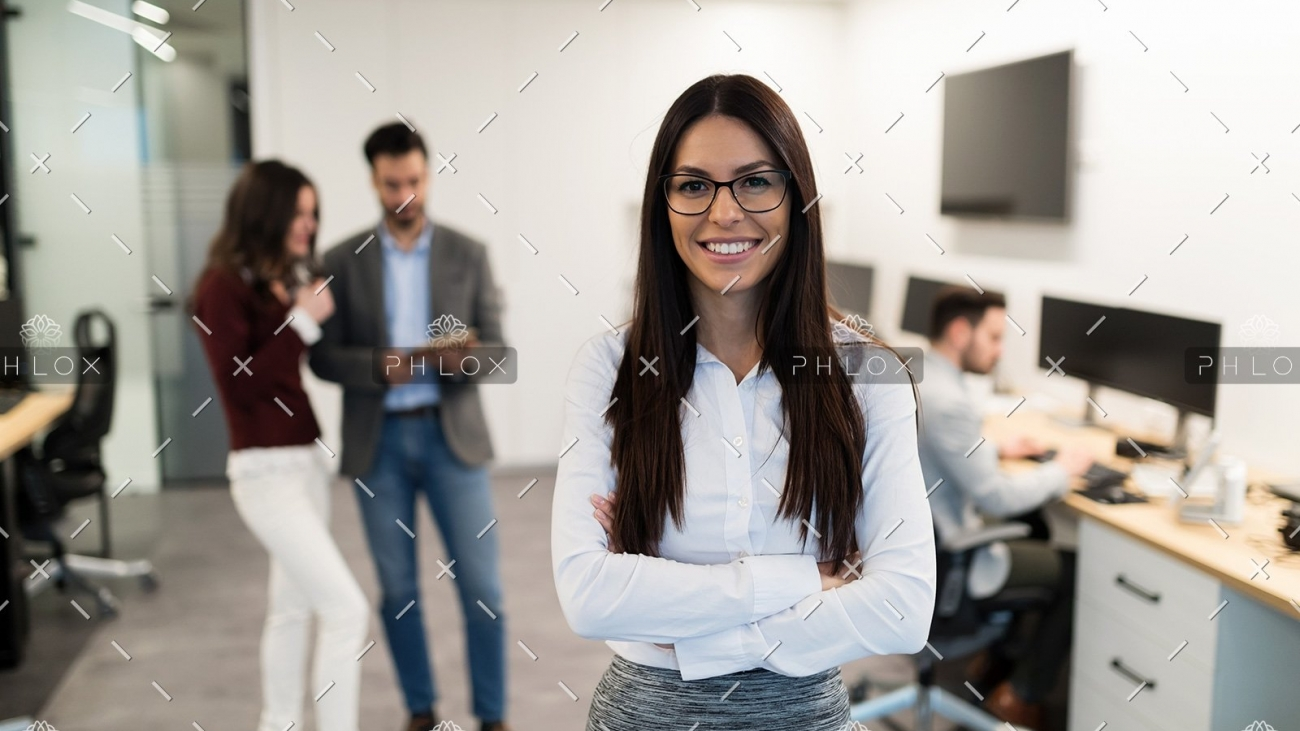 demo-attachment-472-portrait-of-young-businesswoman-posing-in-office-WEU5FBG